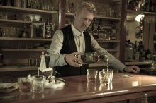 Barman pouring glasses