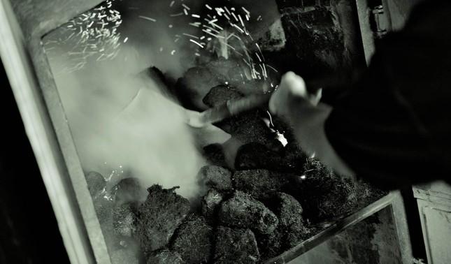 Peat into the furnace. Image courtesy of Laphroaig